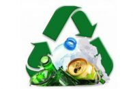 Composition with recyclable garbage consisting of glass, plastic, metal and paper isolated on white background waste re-use